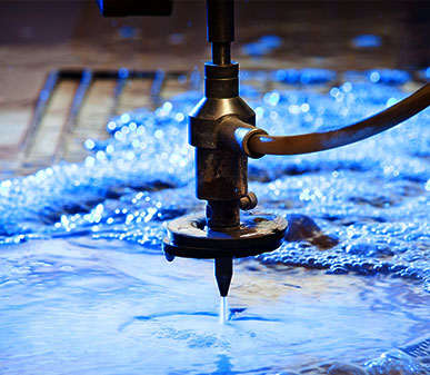 types of cutting machines used in garment industry: Water Jet Cutting Machines